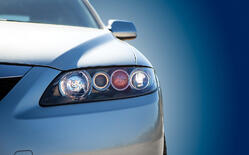 bigstock-Blue-Modern-Car-Closeup-52400029
