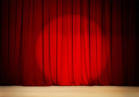 bigstock-red-curtain-with-spot-light-t-64087720